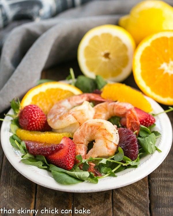 Shrimp, Orange, & Watercress Salad with Citrus Vinaigrette | Peppery watercress, juicy orange segments, strawberries and lemon kissed shrimp with a citrus vinaigrette