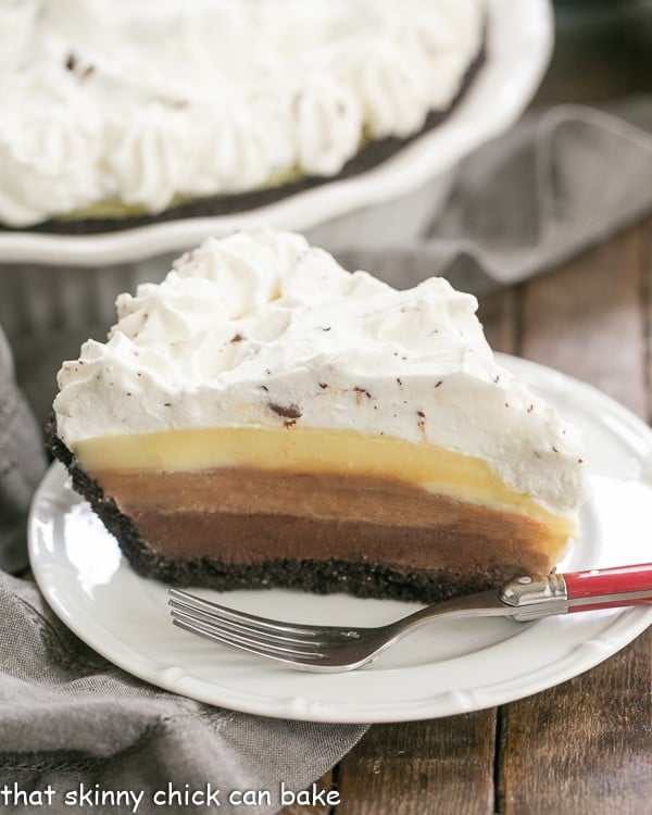 Triple Chocolate Layer Pie Recipe | Cookie crust, 3 rich custards and a cloud of whipped cream!