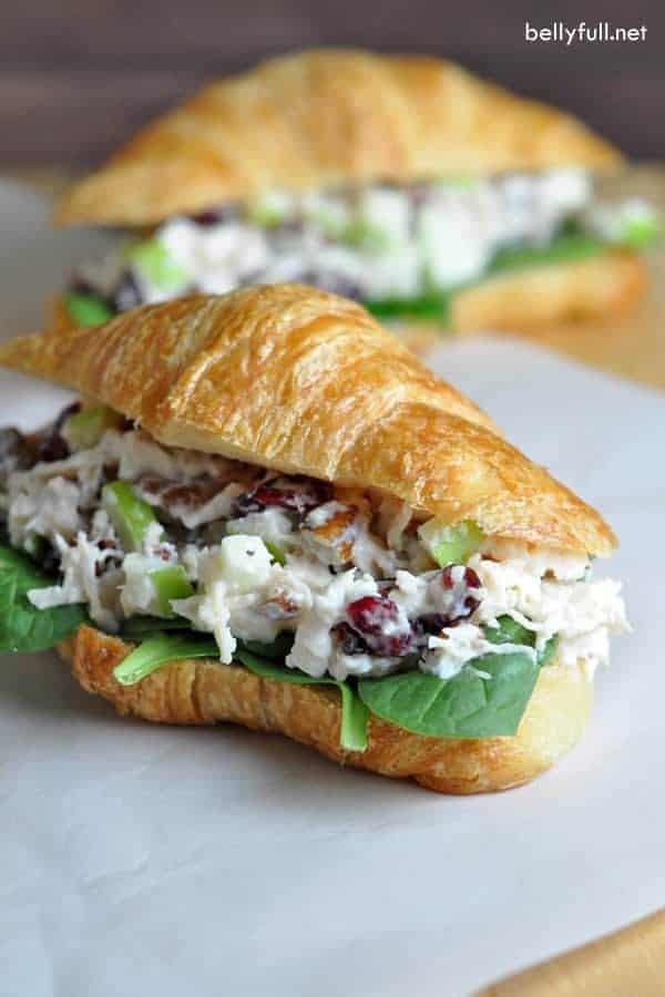 Chicken Salad Sandwich on a croissant on parchment paper