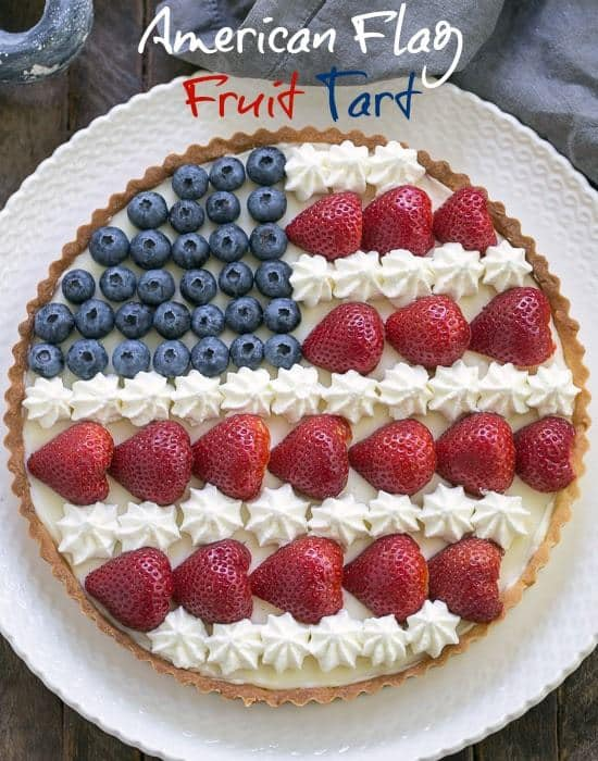 American Flag Fruit Tart - Pate sablee crust, light cream cheese filling and berries and cream stars and stripes! #dessert #tart #flag #patriotic #berries