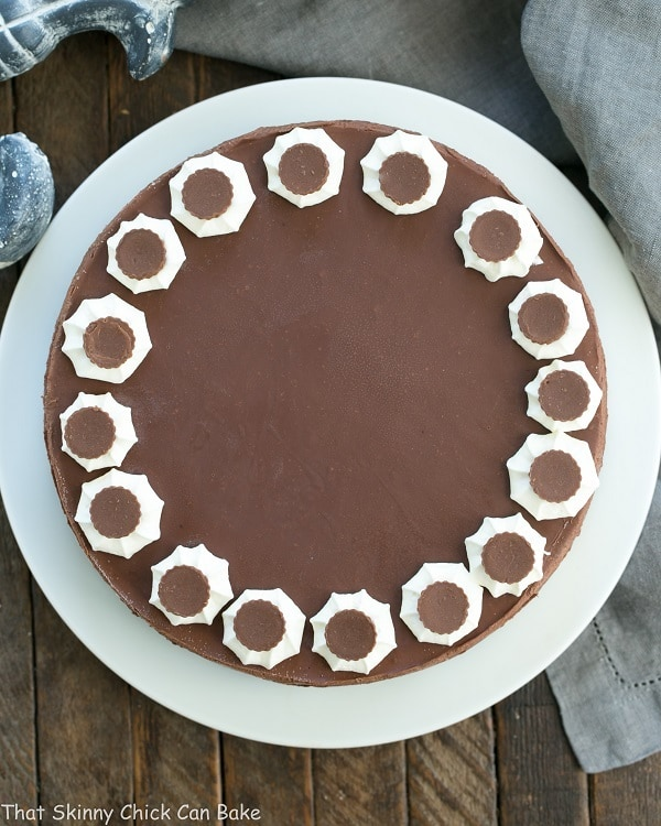 Overhead view of a Chocolate Peanut Butter Pie on a white cake plate