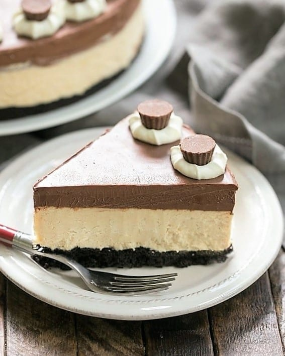 A slice of Chocolate Peanut Butter Pie on a white dessert plate with a red handled fork