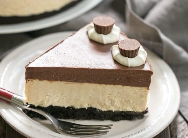 Chocolate Peanut Butter Pie | Chocolate cookie crust, peanut butter mousse and a thick layer of ganache make this one out of this world dessert!