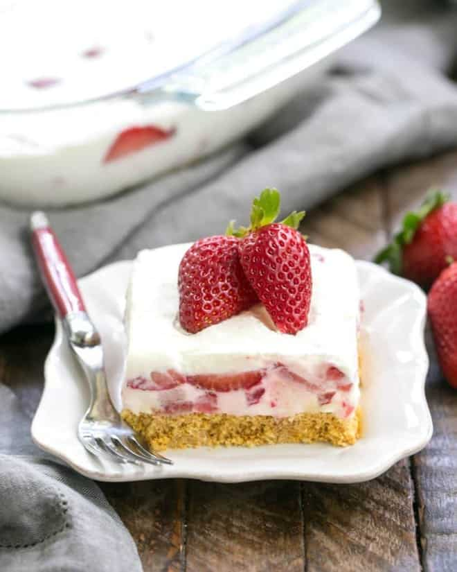 Strawberry Cheesecake Lush Dessert | A dreamy, no-bake treat with a graham cracker crust, berries and cream