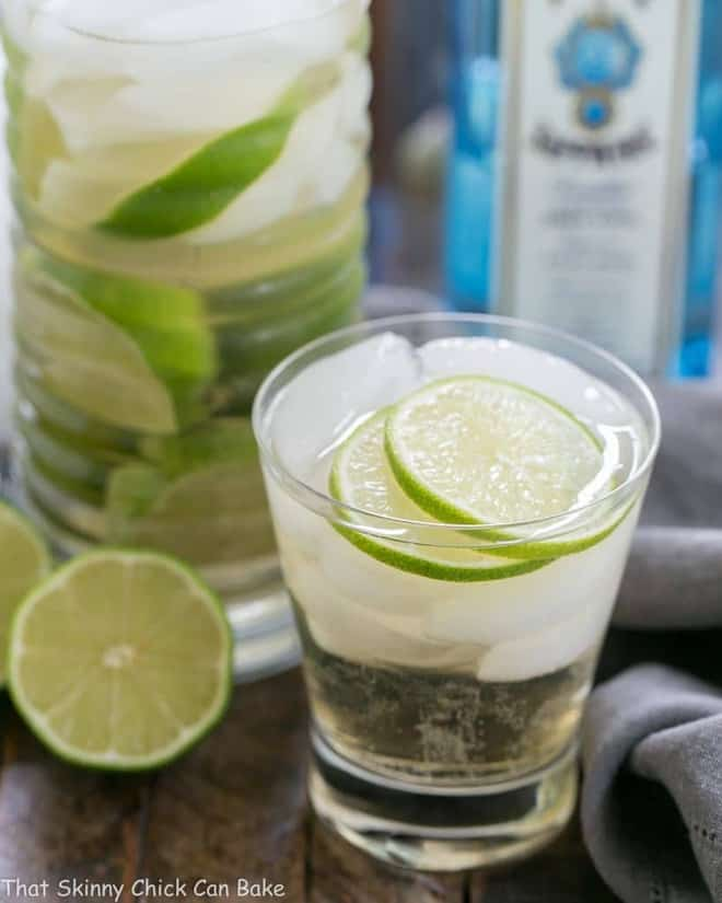 St. Germain Gin and Tonic Cocktail in a short glass with ice cubes and lime slices