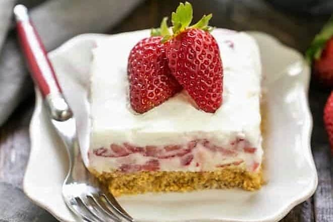 Strawberry Cheesecake Lush Dessert slice on a white dessert plate