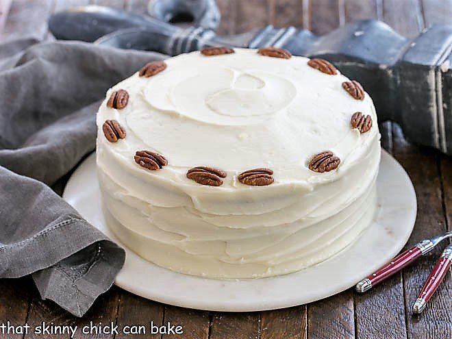 Hummingbird Cake Recipe with coconute on a serving platter