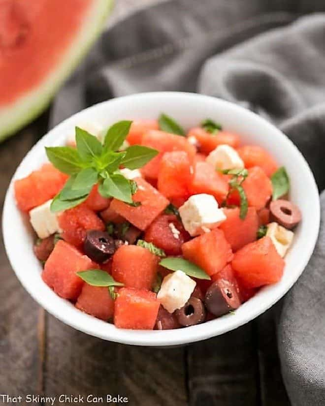 Watermelon Feta Basil Salad with Balsamic Vinaigrette in a white bowl
