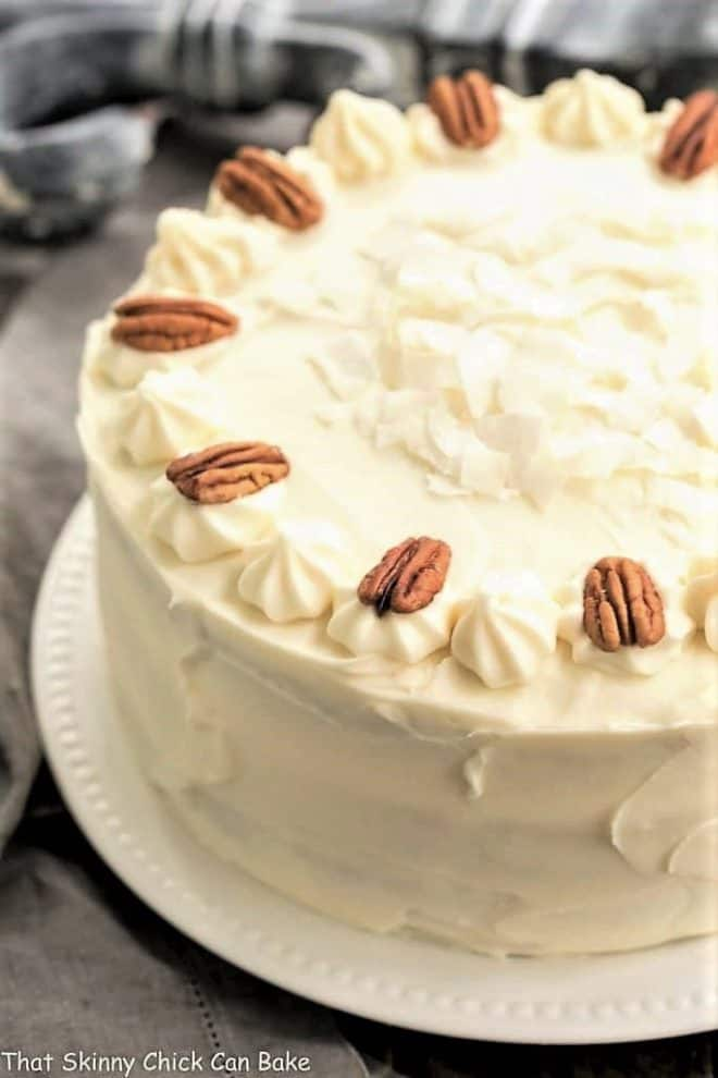 Classic Hummingbird Cake with Coconut on a white serving plate