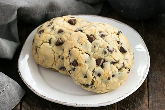 2 levain chocolate chip cookies on a round white plate