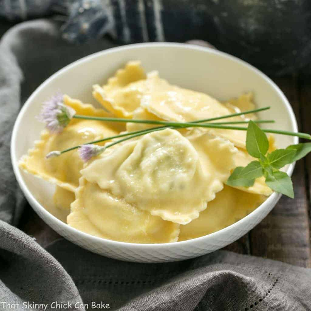 Mozzarella, Basil, Parmigiano-Reggiano Ravioli with Butter Sage Sauce | A simple, delectable egg pasta filled with mozzarella and basil!