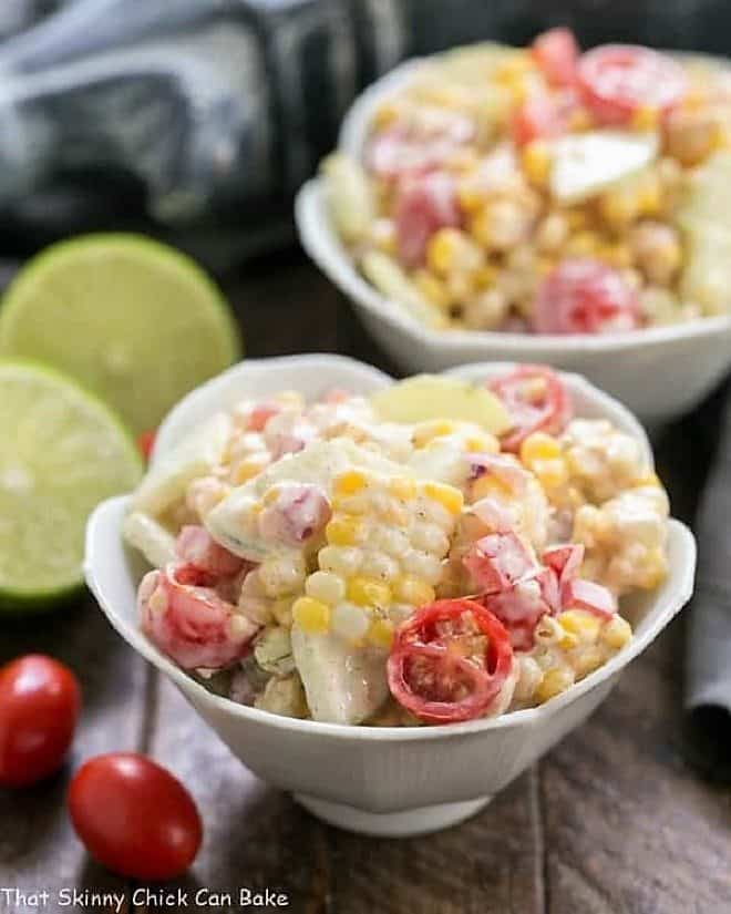 Spicy Mexican Corn Salad in two white tulip bowls