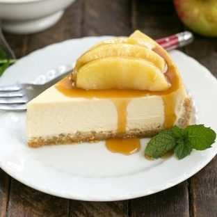 Easy Sour Cream Cheesecake with Caramel Apples | An exquisite brown sugar cheesecake with a bonus topping of caramel laden apples! #cheesecake