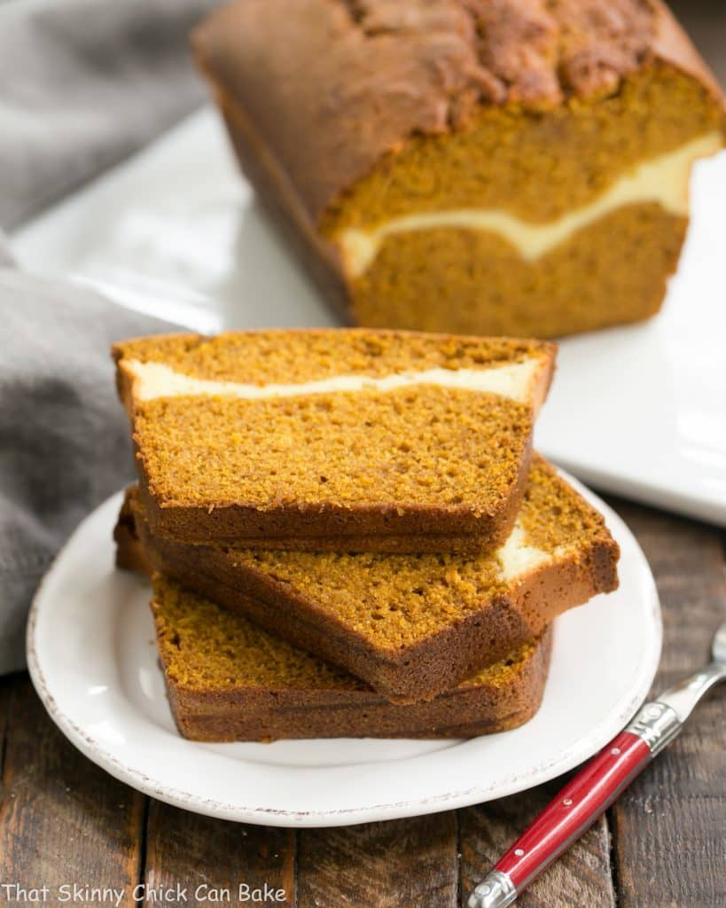 Cream Cheese Filled Pumpkin Bread slices stacked on a white dessert plate