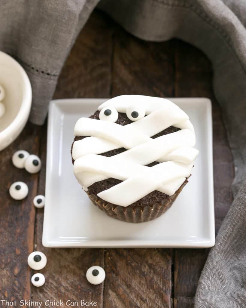 EASY Chocolate Mummy Cupcakes on a square white plate