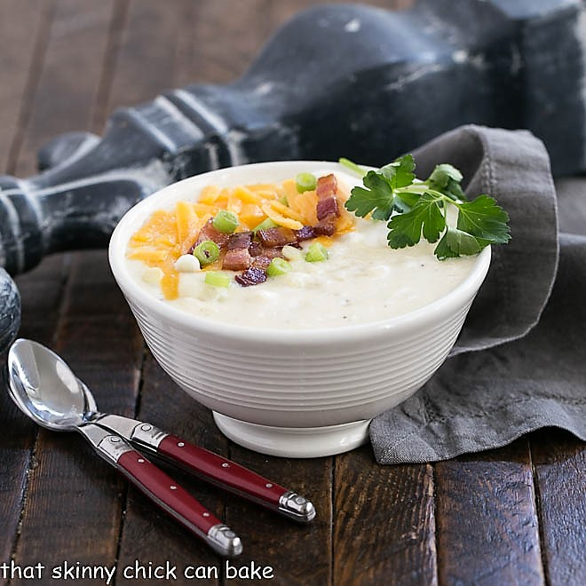 Easy Potato Soup in a white bowl with two soup spoons