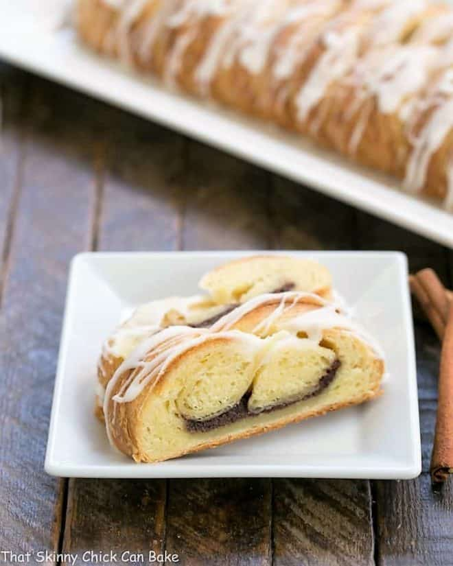 Braided Cinnamon Danish slices on a square white plate