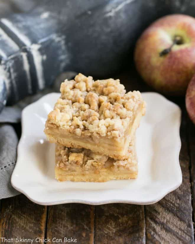 Caramel Apple Pie Toffee Bars stacked on a square white plate