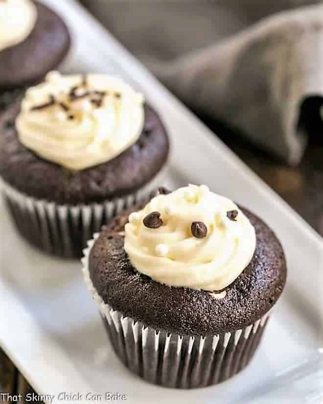 Frosted Black Bottom Cupcakes on a white tray