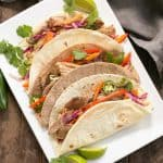 Slow Cooker Asian Pork Tacos with Cabbage Slaw   Shredded pork tacos with an Asian twist!