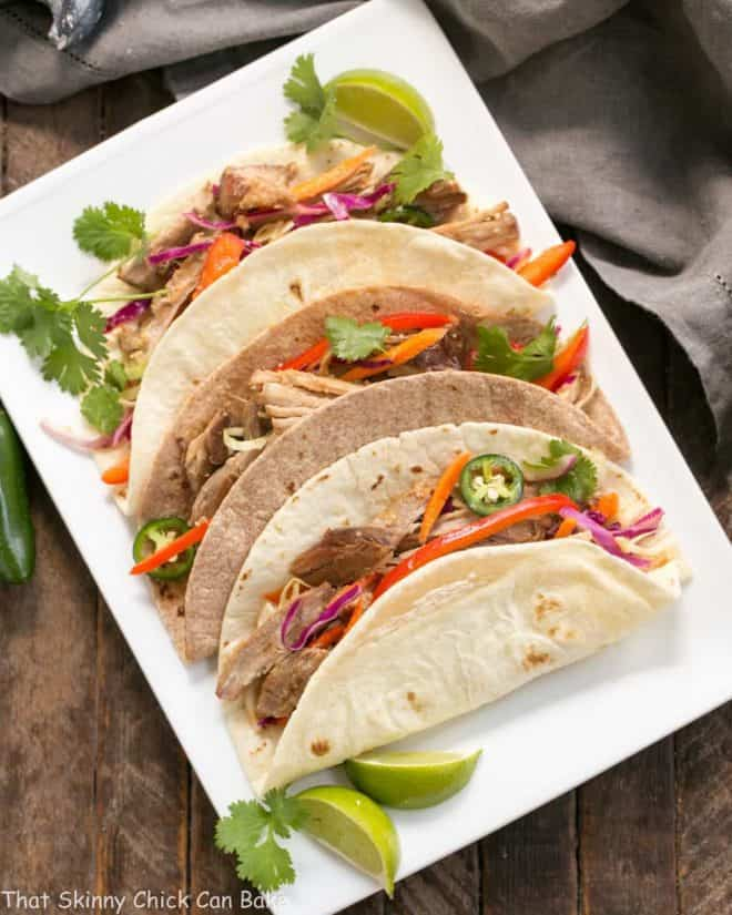 Slow Cooker Asian Pork Tacos with Cabbage Slaw  on a white platter