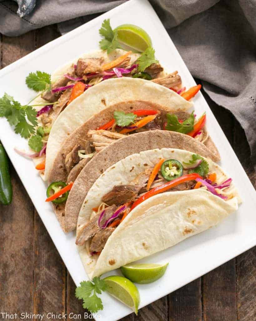 Slow Cooker Asian Pork Tacos with Cabbage Slaw | Shredded pork tacos with an Asian twist!