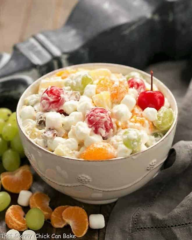 The Best Ambrosia Salad {No Cool Whip} in a white ceramic bowl