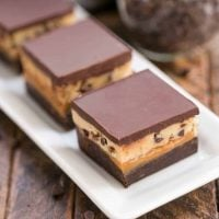 Cookie Dough Billionaire Bars | Layers of brownies, caramel, cookie dough and ganache for an outrageously rich dessert!