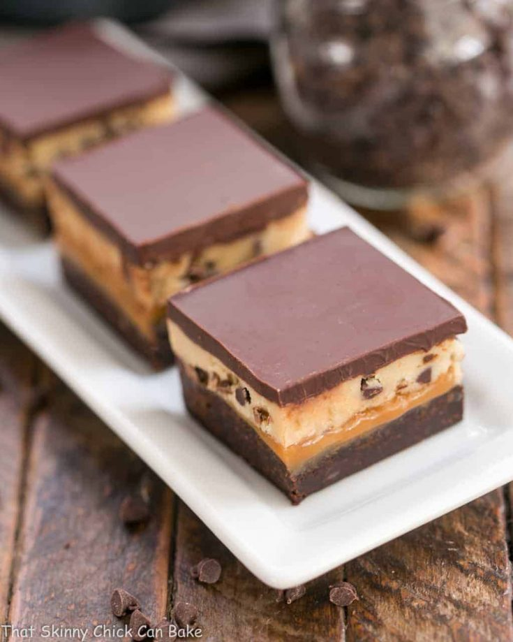 Cookie Dough Billionaire Bars   Layers of brownies, caramel, cookie dough and ganache for an outrageously rich dessert!
