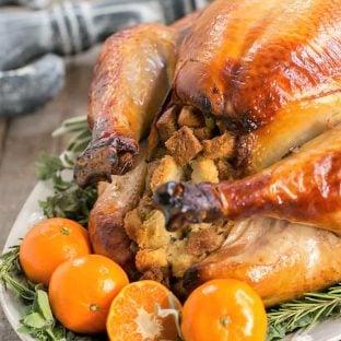 Honey Brined Turkey Recipeon a white serving platter