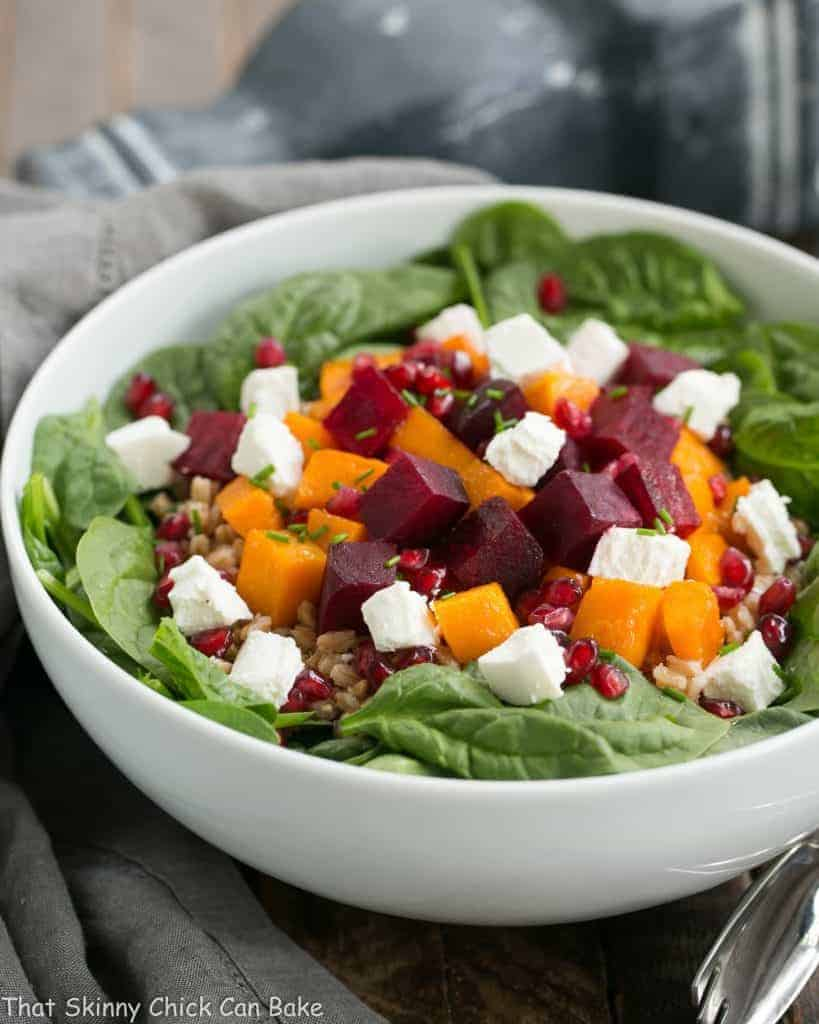 Roasted Fall Vegetable Salad | Roasted beets and butternut squash pair with farro, spinach and goat cheese for a delightful autumnal salad