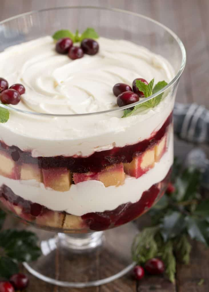 an easy trifle recipe layered into a clear glass trifle bowl