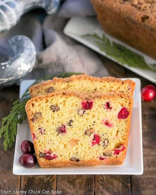 Streusel Topped Cranberry Orange Walnut Bread slices on a small white plate
