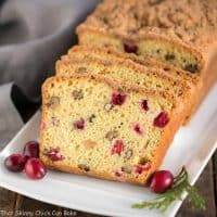 Streusel Topped Cranberry Orange Walnut Bread | Moist, dense cranberry walnut bread with a kick of orange and a rich streusel topping!