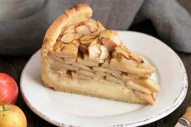Cream Cheese Apple Torte on a round white dessert plate