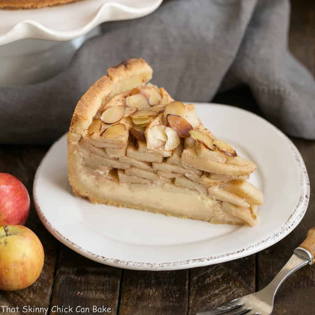 Cream Cheese Apple Torte | A buttery crust is topped with sweetened cream cheese, loads of cinnamon spiced apples, then sliced almonds