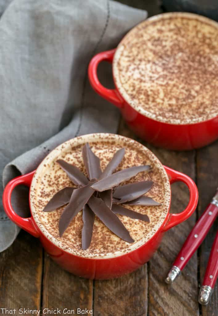 Kahlua Tiramisu for Two in red cocottes garnished with cocoa powder and chocolate shards
