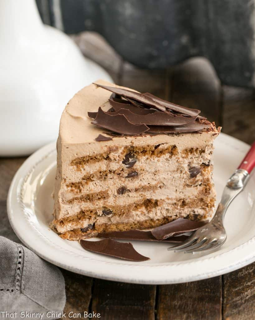 Mocha Chocolate Chip Cookie Icebox Cake on a white plate with a red handled fork