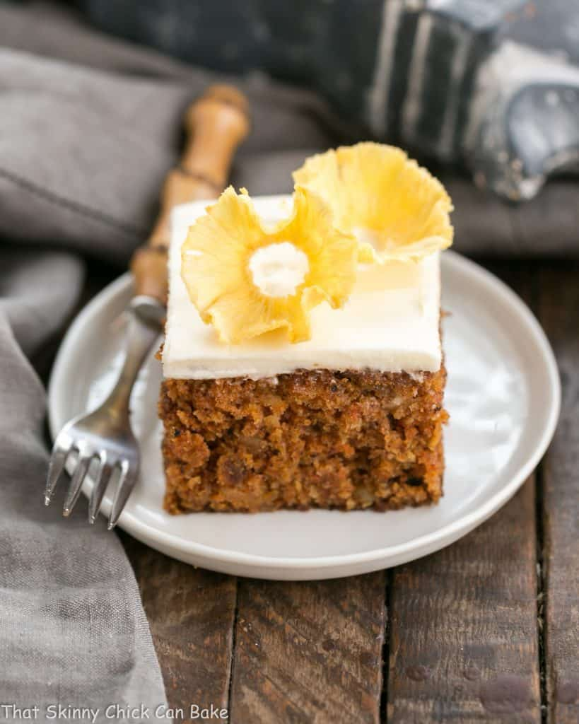 Old Fashioned Carrot Cake with Pineapple Flowers | A dreamy, loaded carrot cake with cream cheese frosting and a beautiful pineapple garnish