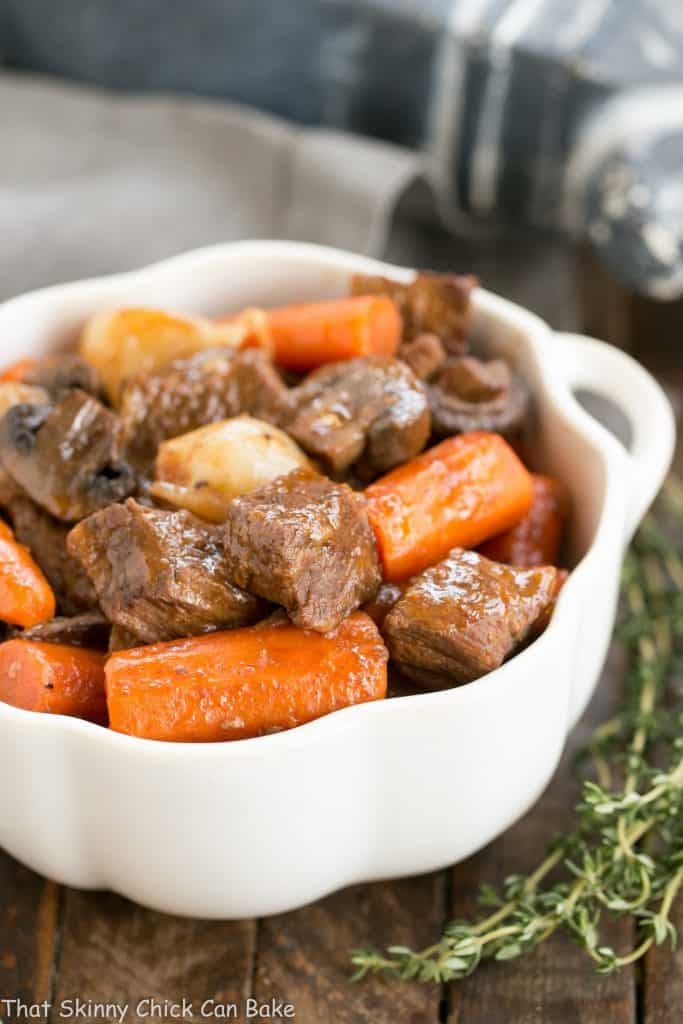 Slow Cooker Beef Stew with Mushrooms in a white bowl