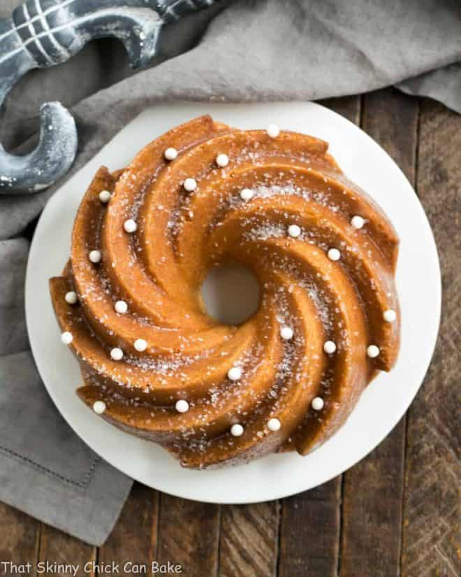 Overhead view of a White Chocolate Bundt Cake on a white serving plate