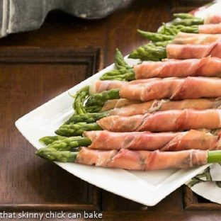 Prosciutto Wrapped Asparagus with Boursin on a serving platter