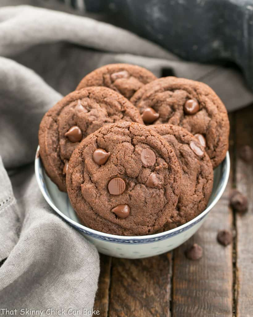Dark Chocolate Pudding Cookies in a blue and white ceramic bowl