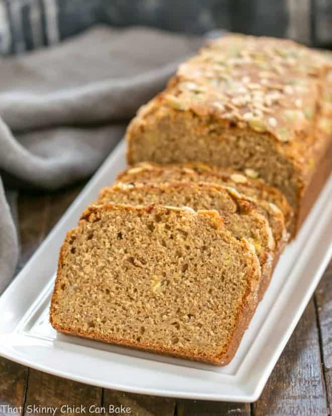 Seed-Topped Whole Wheat Banana Bread slices on a white tray