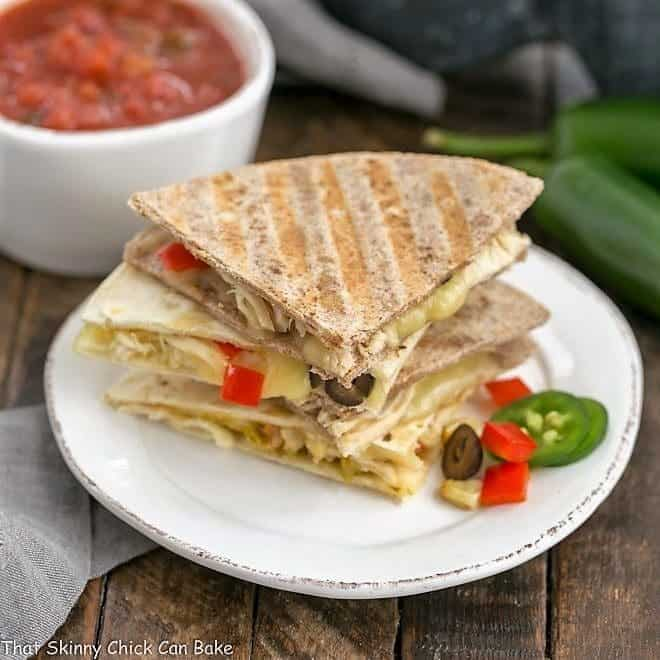 Chipotle Chicken Quesadillas stacked on a white plate