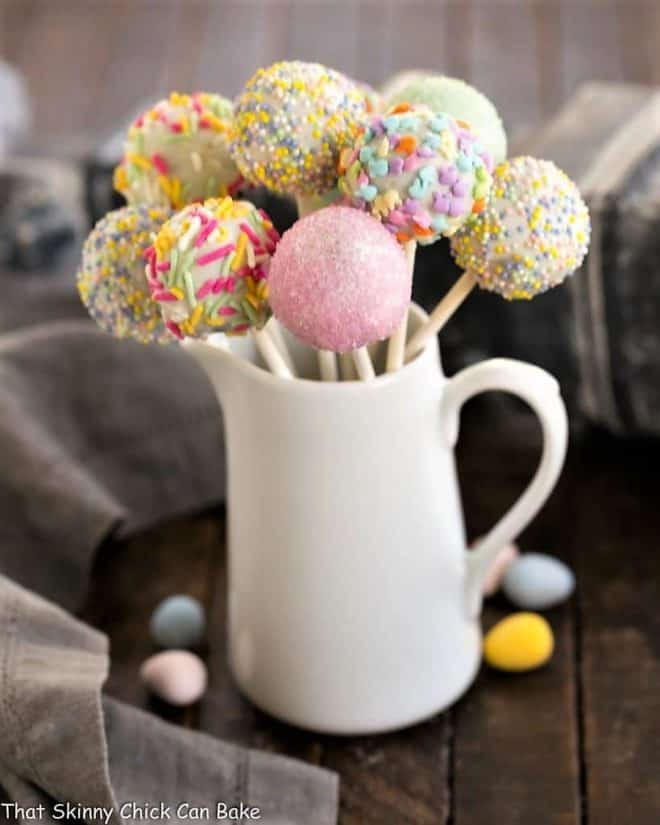 Easter Cake Pops displayed in a ceramic pitcher