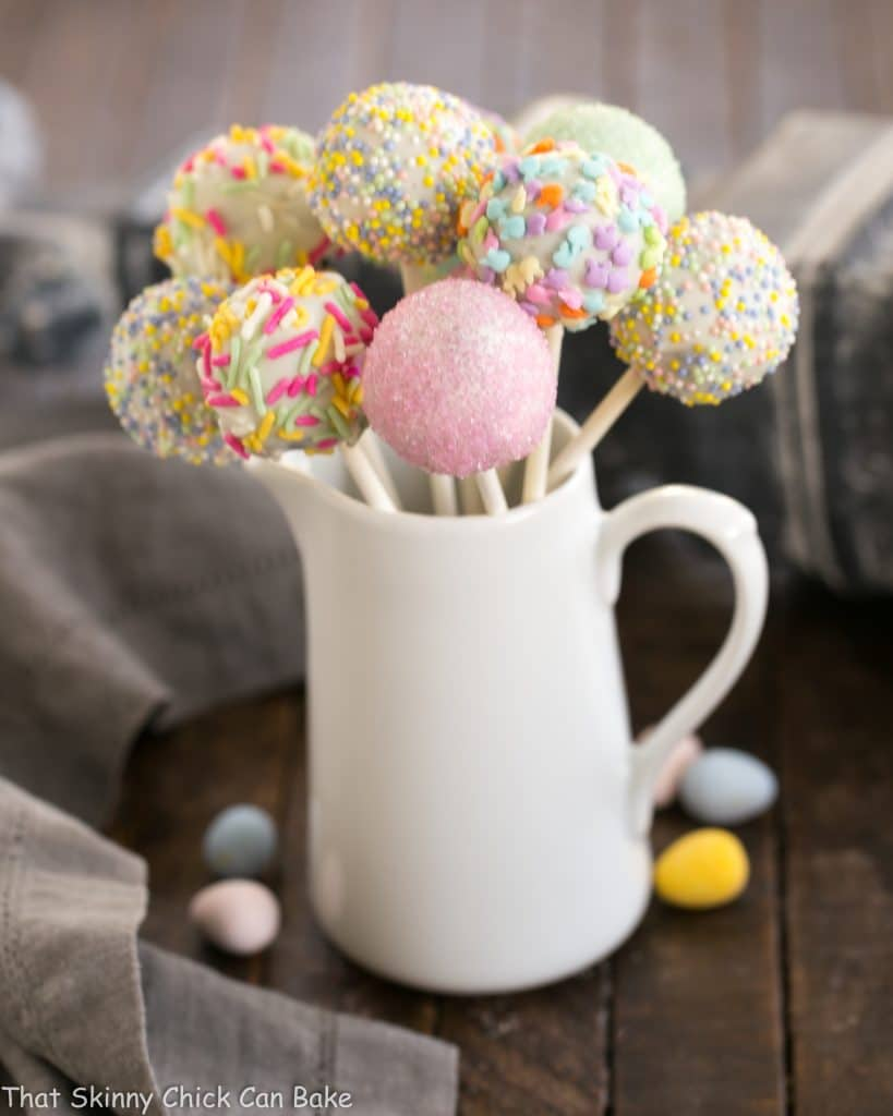 Easter Cake Pops displayed in a ceramic pitchur