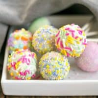 Easter Cake Pops resting on a square plate