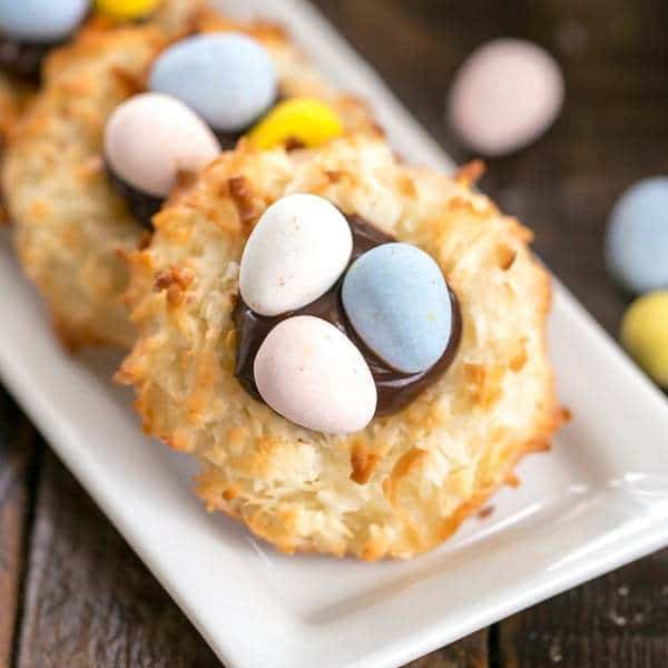 Coconut Macaroon Easter Nests filled with fudge sauce and topped with chocolate eggs!