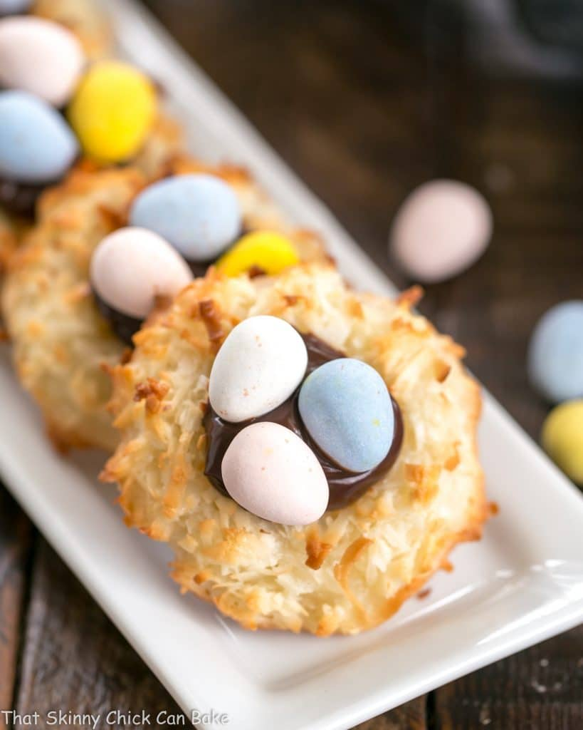 Coconut Macaroon Easter Nests lined up on a thin white tray